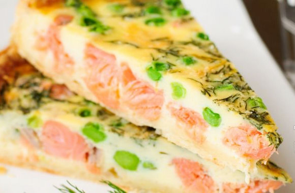 Pie with fish, cheese, shrimps and vegetables